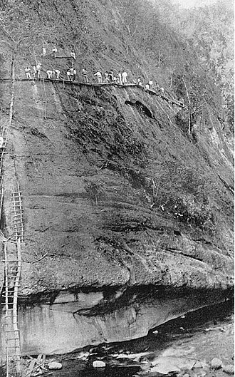 Kennon Road - Benguet Road construction crew near Camp 5, Tuba, Benguet ca1903 setting explosives into a sheer cliff of the Bued River Canyon.