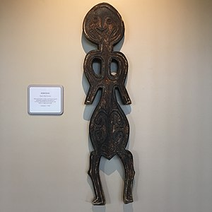 Culture of Papua New Guinea - Bioma figures are wood-carved figures from Papua, New Guinea that have human forms but represent the spirit of animals, particularly those of wild pigs killed in organized hunts. Artifact collected in 1960 and is on a display in the corridor of Hotel Hilton Waikoloa Village, Hawaii, USA.