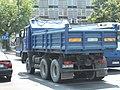 Blue Jelcz truck on Adama Mickiewicza, Zygmunta Krasińskiego, Marszałka Józefa Piłsudskiego and Marszałka Ferdinanda Focha intersection in Kraków.jpg
