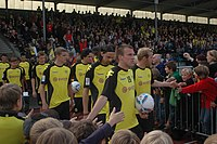 Borussia Dortmund Squad (before a football match and greeted by BVB fans).jpg