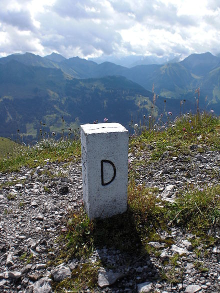 "The letter D, standing for ""Deutschland"" (German for ""Germany""), on a boundary stone at the border between Austria and Germany. Boundary stone on the Demeljoch - 2.jpg"