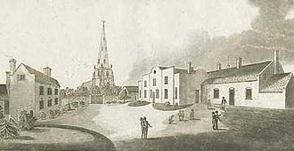 Brewood - The grammar school pictured in 1799, with the parish church in the background.
