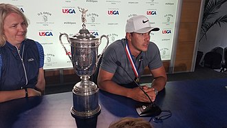 Brooks Koepka - Brooks Koepka and the U.S. Open Trophy at the post tournament press conference at the 2018 USGA U.S. Open at Shinnecock Hills, NY.