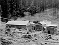 Buildings at camp with cleared land in foreground, probably Washington, between 1900 and 1915 (INDOCC 1762).jpg
