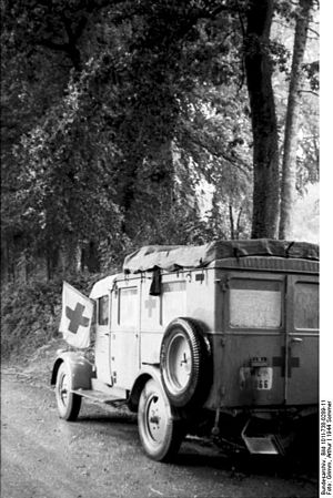 Army Medical Service (Germany) - WWII era ambulance of the Army Medical Service, painted in the neutral and high-visibility color white and displaying the red cross as a protective sign, France, 1944. It is prohibited under the laws of war to attack personnel, vehicles or buildings identified as part of the medical service.