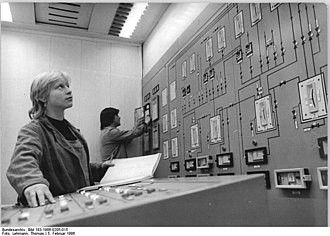 Chemical engineering - Operators in a chemical plant using an older analog control board, seen in East-Germany, 1986.