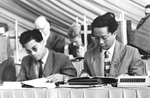 D. N. Aidit and Revang, poring over documents