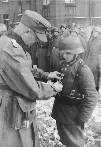 Battle of Berlin - March 1945: Photo of 16-year-old Willi Hübner being awarded the Iron Cross II Class medal for his defense of Lauban