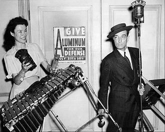 Yankee Network - Buster Keaton and WAAB radio host Ruth Moss in an aluminum drive publicity photo for the Yankee Network, 1942.