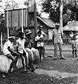 COLLECTIE TROPENMUSEUM Jongens en mannen op straat in kampong Priangan TMnr 20000158.jpg