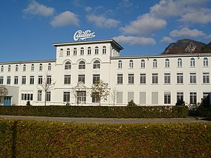 "Cailler - The historical building of the Cailler chocolate factory in Broc, near Gruyères (Switzerland). It also hosts the visitor's centre ""Maison Cailler""."