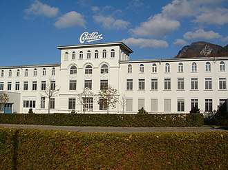 """Cailler - The historical building of the Cailler chocolate factory in Broc, near Gruyères (Switzerland). It also hosts the visitor's centre """"Maison Cailler""""."""