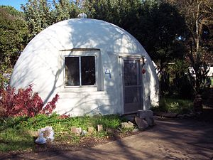 Dome - Fiberglass dome cottage in Davis, California. This dome was built in 1972 and is part of the Baggin's End student housing cooperative.