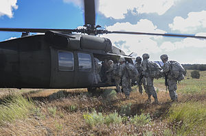 California National Guard - Californian national guardsmen board a UH-60 Blackhawk during training at Camp Williams, Utah in 2014.