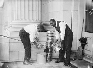 Spittoon - Janitors at the United States Capitol with stack of spittoons, 1914