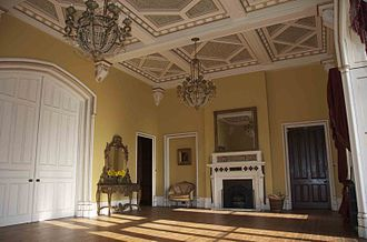 Castle Oliver - Ballroom with verre eglomise fireplace, Gothic-arched doors connect to drawing room