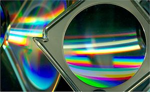 Scanography - A magnifying glass and CD-ROM discs placed at an angle to the bed show reflection, refraction, and diffraction effects that can be generated.