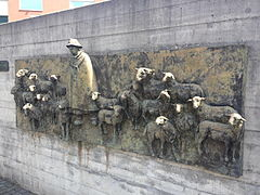 Relief Shepherd and flock, Bronze 360 x 110 cm, front of the entrance to the Centro Evangelico Magliaso, Canton Ticino, Switzerland. Centro magliaso relief.jpg
