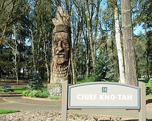 Chief Kno-Tah - Front of the sculpture along with city park sign