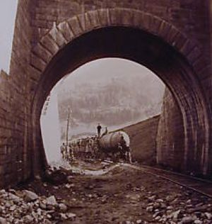 Airolo - Compressed air-driven train entering the Gotthard tunnel during construction