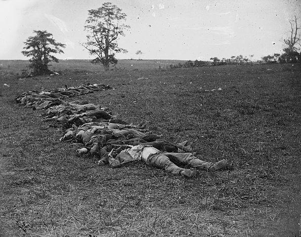 609px-Confederate_dead_gathered_for_buri