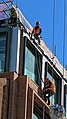 Construction workers on Distaff Lane building site, City of London England.jpg