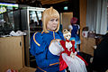 Cosplayer and doll of Saber from Fate-stay night in Desucon Frostbite 2013.jpg