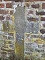 Croix de pierre - mur église Sainte-Geneviève.jpg