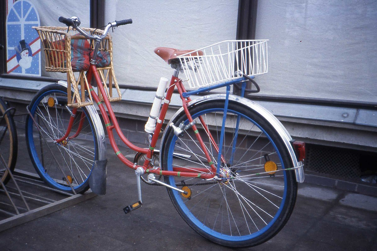 DDR Fahrrad Bicycle with wicker child seat.DDR. Jan 1990 (3708246630).jpg