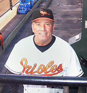 Dave Trembley in his Orioles uniform behind the dugout railing