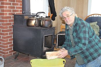 David at woodstove- small.JPG