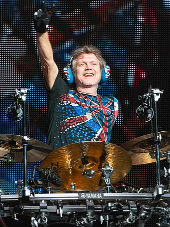 After losing his left arm in a car accident, drummer Rick Allen (pictured in 2018) used his legs to play a custom electronic drum kit.