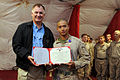 Defense.gov News Photo 101028-D-7203C-052 - Deputy Secretary of Defense William J. Lynn III poses with Cpl. Jackson Hester after presenting him a purple heart for wounds received in Afghanistan.jpg