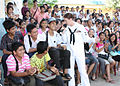 Defense.gov News Photo 101029-N-5773W-684 - U.S. Navy Petty Officer 3rd Class Nina Church center sings to students at a high school in Sihanoukville Cambodia on Oct. 29 2010. Church is.jpg