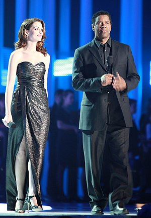Denzel Washington - Washington with Anne Hathaway at The Nobel Peace Prize Concert in 2010