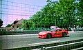 Dodge Viper RT10 - Rene Arnoux, Justin Bell & Bertrand Balas passes the Hunadieres restaurant on the Mulsanne Straight at the 1994 Le Mans (31822417242).jpg
