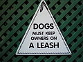Dogs must keep owners on a leash (Butchart Gardens)-WTF.jpg