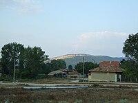 Dscf10471 village Partizani rock in background.jpg