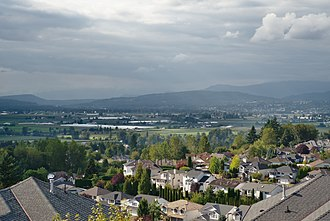 Abbotsford, British Columbia - Private residences near Upper Ten Oaks in eastern Abbotsford looking north-by-northwest towards Mission, BC