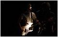 Electric Bassist in stark lighting.JPG