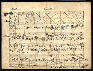 eleven-staved music manuscript sheet written in black ink, headed 'Secondo'