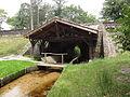 Escource (Landes) pont-lavoir sur l'Escource.JPG