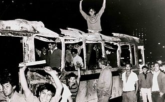 Students in a burned bus during the protests of 1968 Estudiantes sobre cammion quemado (A68).JPG