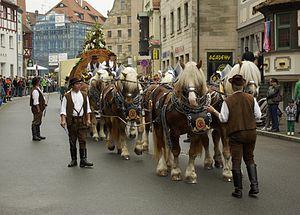 Rhenish German Coldblood - Six Rhenish German Coldbloods drawing a beer wagon in Fürth