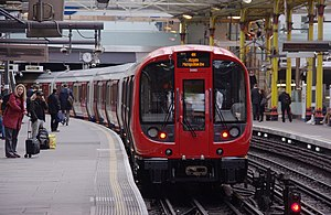 Farringdon station - A Metropolitan line S Stock train departing Platform 1 with an Eastbound service to Aldgate