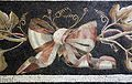 Fascia mosaicata da una soglia tra stanze, con vite nera e bianca intrecciate e grosso fiocco, 20-1 ac ca. 04.jpg