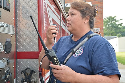 Firefighter using walkie-talkie Faster communications aid Marine, civilian first responders 130827-M-KX456-009.jpg