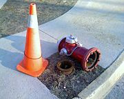 A fire hydrant that was hit by a snow plow and knocked over. Note that only the sacrificial bolts were damaged