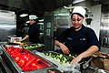 Flickr - Official U.S. Navy Imagery - CA native-Sailor prepares cucumbers in the aft galley of USS Ronald Reagan.jpg