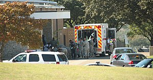 2009 Fort Hood shooting - First responders prepare the wounded for transport in waiting ambulances outside Fort Hood's Soldier Readiness Processing Center.